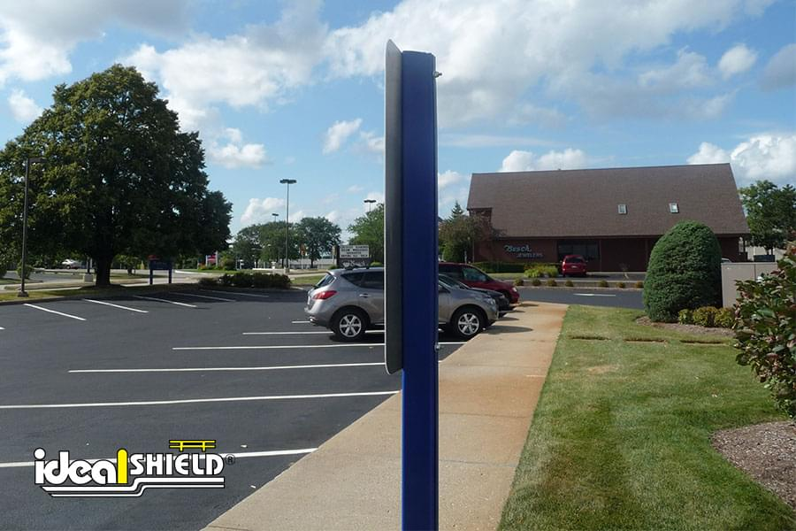 Side View Of Handicap Sign with Ideal Shield's Blue U-Channel Cover