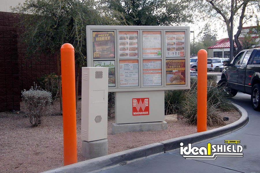 Ideal Shield's orange bollard covers guarding a Whataburger drive-thru kiosk