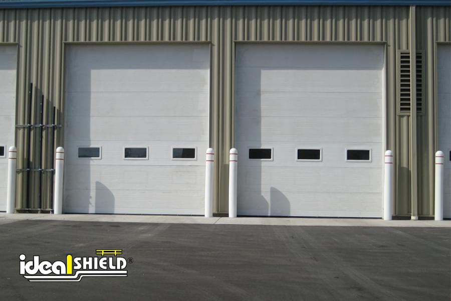 """Ideal Shield 1/8"""" White Bollard Covers with Reflective Tape Protecting Garage Doors"""
