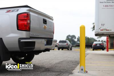 Ideal Shield's Collapsible Locking Bollard behind truck