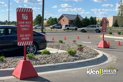 Ideal Shield's Red Pyramid Sign Bases used for drive thru directions at Chick Fil A