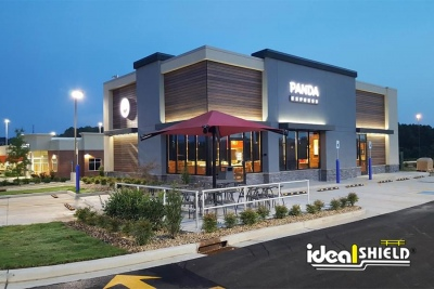 Ideal Shield's Aluminum Handrail around an outdoor eating patio at Panda Express