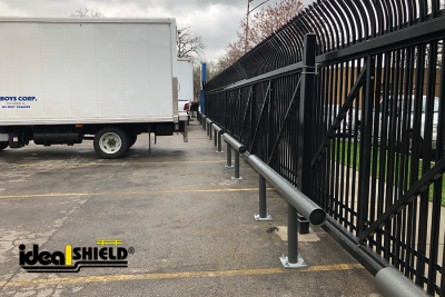 Ideal Shield's One Line Standard Guardrail in Gray used for parking lot fence protection