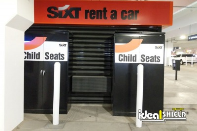Ideal Shield's White Bollard Covers at a car rental location