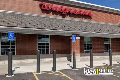 Ideal Shield's Gray Bollard Sign Systems and Bollard Covers used for storefront protection at Walgreens