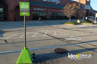 Ideal Shield's custom Lime Green Pyramid Sign Bases used for curbside pickup at Dierberg's