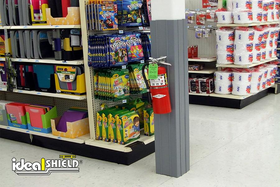 Ideal Shield Gray Square Column Wraps with fire extinguisher at a grocery store