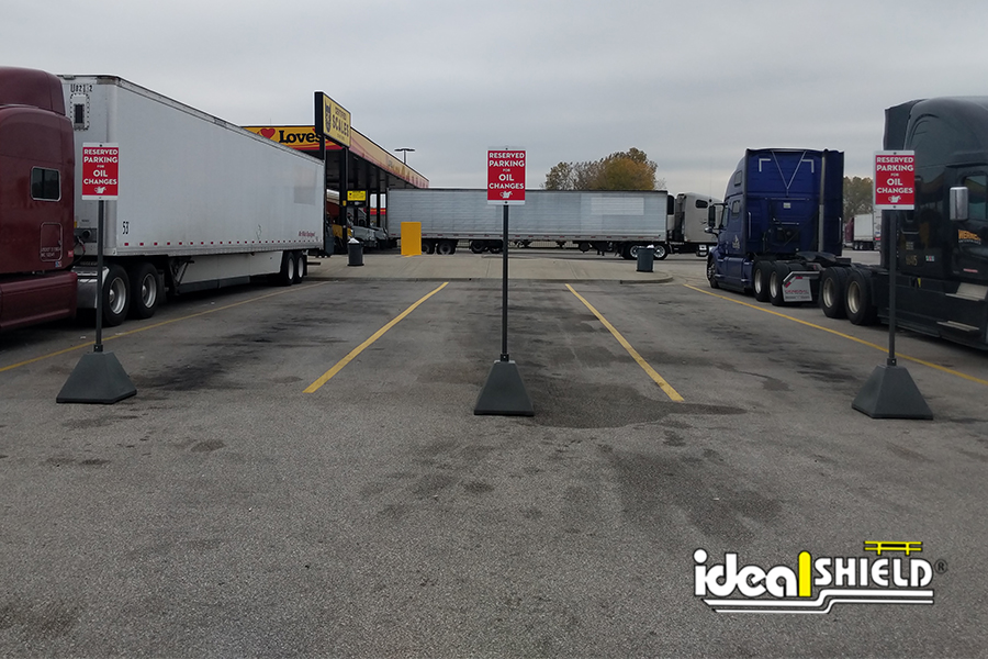 Ideal Shield's Gray Pyramid Sign Bases used for truck stop parking markings