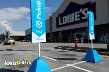 Ideal Shield's Pyramid Sign Bases at Lowe's Curbside Pickup parking spots