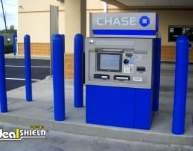 "Ideal Shield's blue 1/4"" Bollard Covers guarding an ATM at Chase Bank"