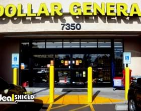 "Ideal Shield's yellow 1/4"" Bollard Covers guarding a Dollar General storefront"