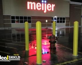 Ideal Shield's yellow plastic Bollard Covers guarding a fire hydrant outside of Meijer