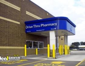 "Ideal Shield's yellow 1/4"" Bollard Covers guarding a Rite Aid pharmacy drive-thru"