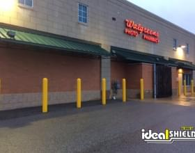 "Ideal Shield's yellow 1/4"" Bollard Cover at Walgreens Pharmacy"