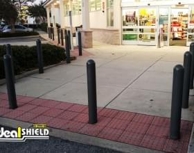 "Ideal Shield's 1/4"" Bollard Covers guarding a Walgreen's entrance."