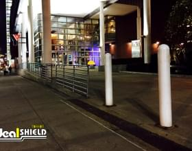 "Ideal Shield's white 1/4"" Bollard Covers guarding sidewalk of the YMCA in Downtown Detroit"