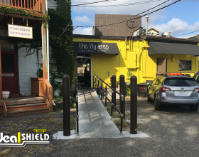Ideal Shield Bollard Covers and Handrail at a restaurant handicap accessible ramp entrance