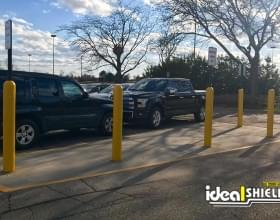 Ideal Shield's yellow Bollard Covers and Bollard Sign Systems in a mall parking lot