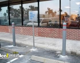 "Ideal Shield's grey 1/8"" Bollard Covers with red reflective stripes"