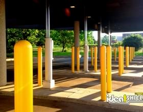"Ideal Shield's yellow 1/8"" Bollard Cover at Bank ATM Drive-Thru"