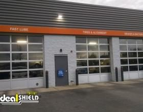 """Ideal Shield's 1/8"""" Bollard Covers with orange reflective tape at Quick Lane"""