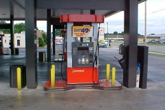 Ideal Shield's yellow Square Bollard Covers used for gas station pump protection