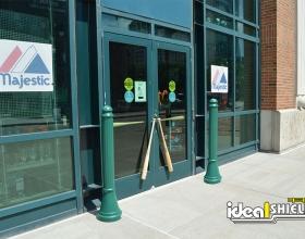 Green Paramount Decorative Bollard Covers Protecting Storefront