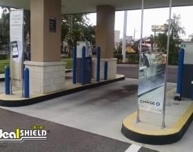 "Ideal Shield's plastic 1/4"" Bollard Covers at a Chase Bank ATM drive-thru"