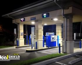 "Ideal Shield's blue plastic 1/4"" Bollard Covers at a Chase Bank ATM drive-thru"