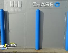 "Ideal Shield's blue plastic 4"" Bollard Covers at a Chase Bank ATM drive-thru"