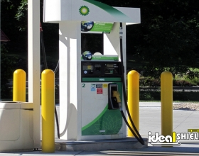 "Ideal Shield's 1/4"" yellow Bollard Covers at BP gas station"
