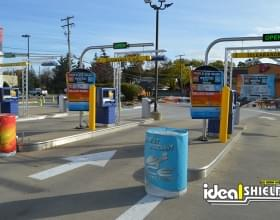 "Ideal Shield's 1/4"" yellow Bollard Covers used to protect car wash entry"