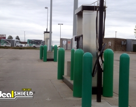 "Ideal Shield's 1/4"" green Bollard Covers at Clean Energy pump station"