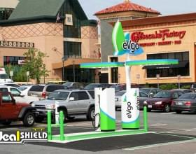 "Ideal Shield's lime green 1/4"" Bollard Covers protecting an Electric Vehicle Charging Station"