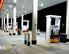 "Ideal Shield's white 1/4"" Bollard Covers at Shell gas station"