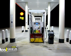 "Ideal Shield's 1/4"" White Bollard Sleeve at Shell gas station"