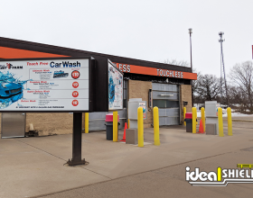 "Ideal Shield's 1/4"" yellow Bollard Covers used to protect car wash payment kiosks"
