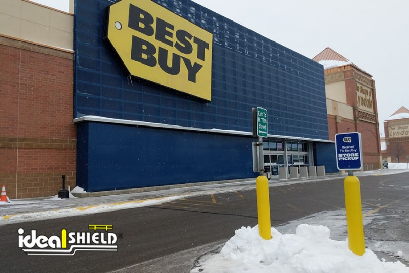 Ideal Shield's Yellow Bollard Sign Systems used for designated parking at Best Buy