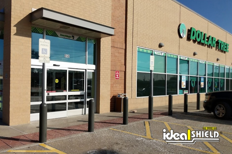 Ideal Shield's Dark Gray Bollard Sign Systems used for designated parking at Dollar Tree