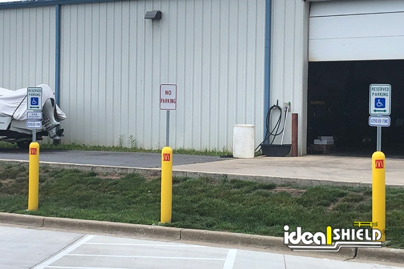 Ideal Shield's Yellow Bollard Sign Systems with decals used for designated parking at McDonald's