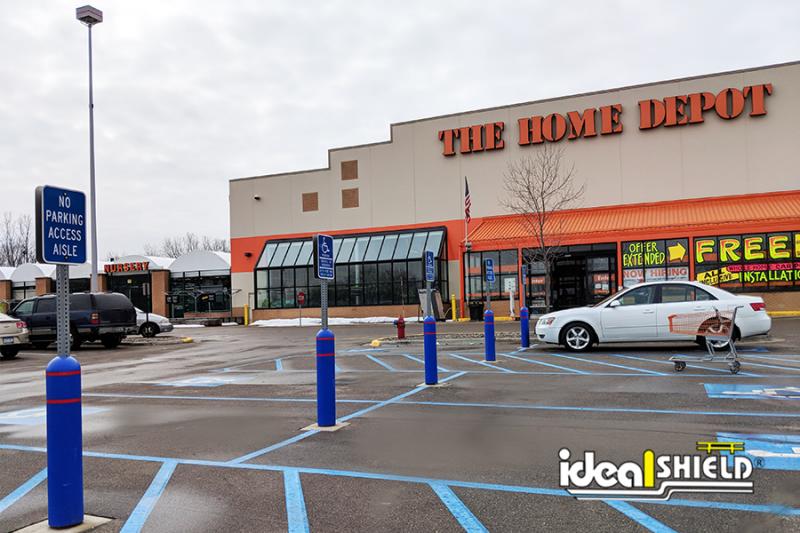 Ideal Shield's Blue Bollard Sign Systems with red reflective tape used for designated parking at Home Depot