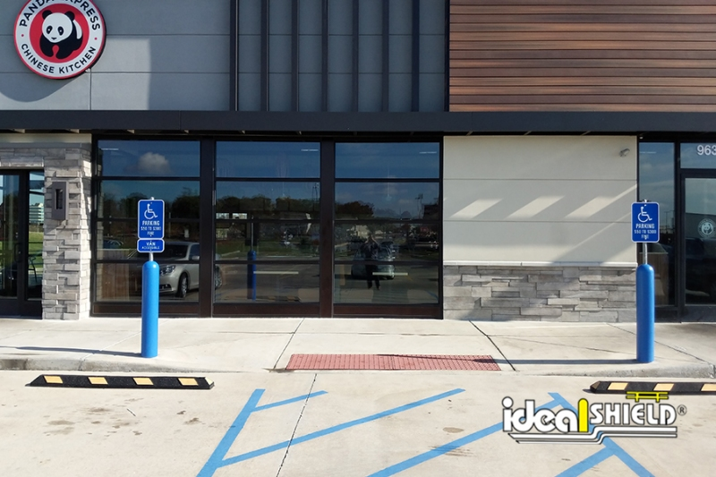 Ideal Shield's 285 Blue Bollard Sign Systems used for designated handicap parking at Panda Express