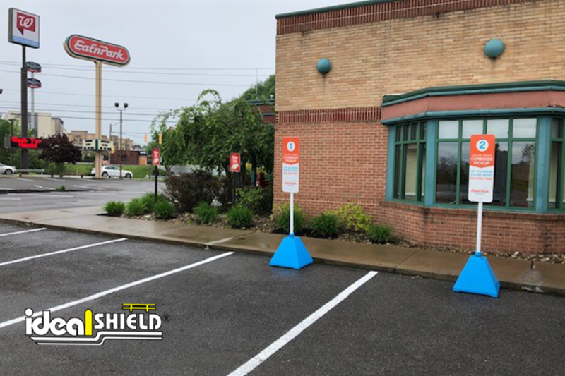 Ideal Shield's custom Carolina Blue Pyramid Sign Bases used for curbside pickup at Eat N' Park