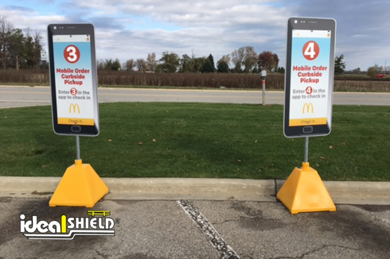 Ideal Shield's custom Dollar Gold Designated Curbside Pickup Sign Bases at McDonald's