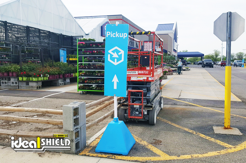 Ideal Shield's custom Carolina Blue Curbside Pickup Sign Bases used for directional help at Lowe's