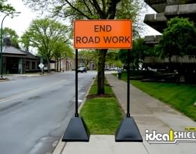 Two of Ideal Shield's black Sign Bases used for a End Road Work sign at a construction site