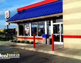 "Ideal Shield's 1/4"" red Bollard Covers at Burger King"