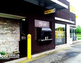 "Ideal Shield's 1/4"" custom logo yellow Bollard Covers at McDonald's drive-thru"