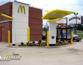 "Ideal Shield's 1/4"" yellow Bollard Covers at McDonald's drive-thru"