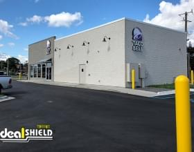 """Ideal Shield's yellow plastic 1/4"""" Bollard Covers at Taco Bell"""